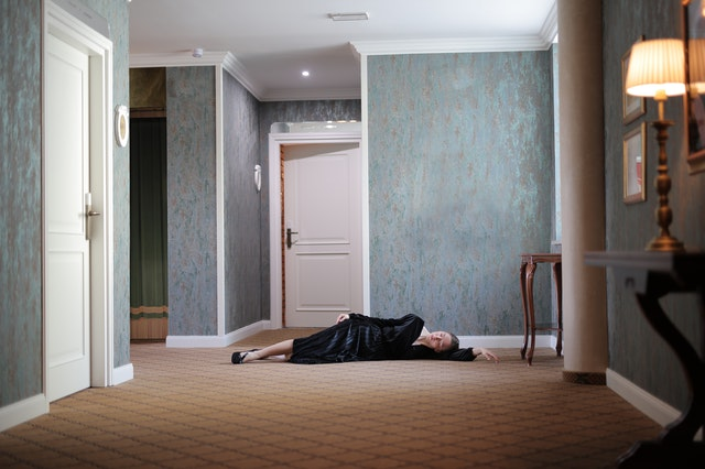 person-lying-on-the-floor-near-a-door